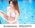 woman in pool on summer vacation | Shutterstock . vector #398153974