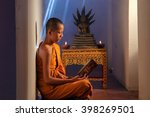 young novice monk reading a... | Shutterstock . vector #398269501