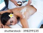 woman enjoying a salt scrub...   Shutterstock . vector #398299135