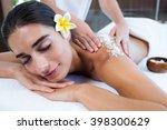 woman enjoying a salt scrub... | Shutterstock . vector #398300629