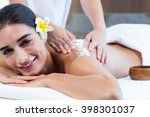 woman enjoying a salt scrub...   Shutterstock . vector #398301037