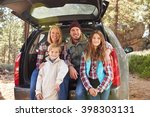 portrait of family by their car ... | Shutterstock . vector #398303131
