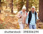senior couple hold hands hiking ... | Shutterstock . vector #398306194