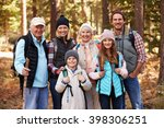Small photo of Multi generation family on hike in forest, group portrait
