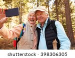 senior couple on hike in a... | Shutterstock . vector #398306305