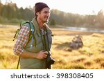 Man Hiking With Camera In...
