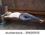 sleeping homeless man on the...   Shutterstock . vector #39830935