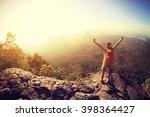 cheering woman hiker open arms... | Shutterstock . vector #398364427