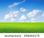 green field  blue sky and white ... | Shutterstock . vector #398403175