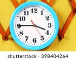 wall clock on the wood... | Shutterstock . vector #398404264