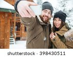 happy young couple standing and ... | Shutterstock . vector #398430511