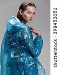 girl in a transparent raincoat... | Shutterstock . vector #398452051