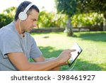 young man relaxing with a... | Shutterstock . vector #398461927