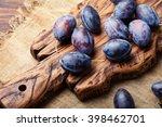 Fresh Organic Plums On Rustic...