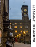 Small photo of London, United Kingdom - March 23, 2016: Street view of the Medieval Tower, with a suit of armour and a red telephone cabin near the clocktower in London, United Kingdom, on the 23rd of March 2016.