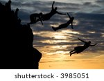 Combined images of a man jumping off a rock in Waimea Beach - stock photo