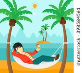 man chilling in hammock. | Shutterstock . vector #398584561