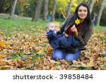 baby boy with mother play in... | Shutterstock . vector #39858484