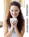 beautiful woman drinking a cup... | Shutterstock . vector #39860584