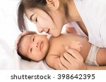 happy mother holding adorable... | Shutterstock . vector #398642395