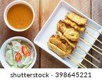 pork satay grilled pork served...   Shutterstock . vector #398645221