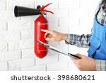 man inspecting the fire... | Shutterstock . vector #398680621