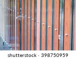 Small photo of alloy hasp on the alloy wood door