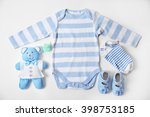 baby clothes with toys on white ... | Shutterstock . vector #398753185