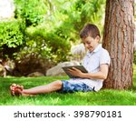 child with tablet pc outdoors.... | Shutterstock . vector #398790181