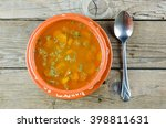 soup in a clay plate on a... | Shutterstock . vector #398811631