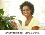 woman looking after houseplant | Shutterstock . vector #39882448