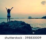 happy woman with hands up... | Shutterstock . vector #398830009