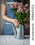 Small photo of Alstroemeria bouquet of beautiful flowers and delicate girl in the background