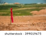 metal survey peg with red flag