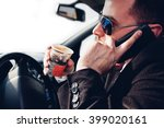 man drinking coffee and using... | Shutterstock . vector #399020161