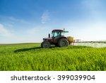 Farmer Spraying Green Wheat...