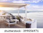 living on a terrace in oia at... | Shutterstock . vector #399056971