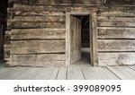 log cabin with open front door. ... | Shutterstock . vector #399089095