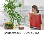 young woman drinking water near ... | Shutterstock . vector #399163465