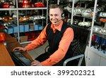 smiling salesman auto parts... | Shutterstock . vector #399202321