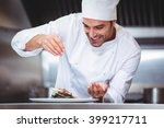 chef sprinkling spices on dish... | Shutterstock . vector #399217711