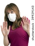 scared young woman wearing a protective mask to protect her from swine flu - stock photo