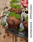 chocolate muffins with mint on... | Shutterstock . vector #399312061