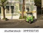 tuk tuk is parking in front of... | Shutterstock . vector #399550735