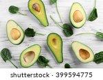 avocado on a light wooden... | Shutterstock . vector #399594775