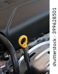 Small photo of oil dipstick of car engine