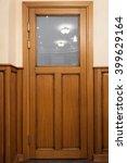 wooden brown door with glass | Shutterstock . vector #399629164