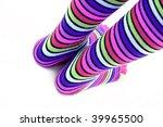 woman legs in strip sock on... | Shutterstock . vector #39965500