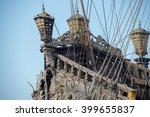 gold statues on pirate sail ship detail - stock photo