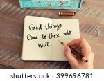Small photo of Retro effect and toned image of a woman hand writing on a notebook. Handwritten quote Good Things Come To Those Who Wait as inspirational concept image